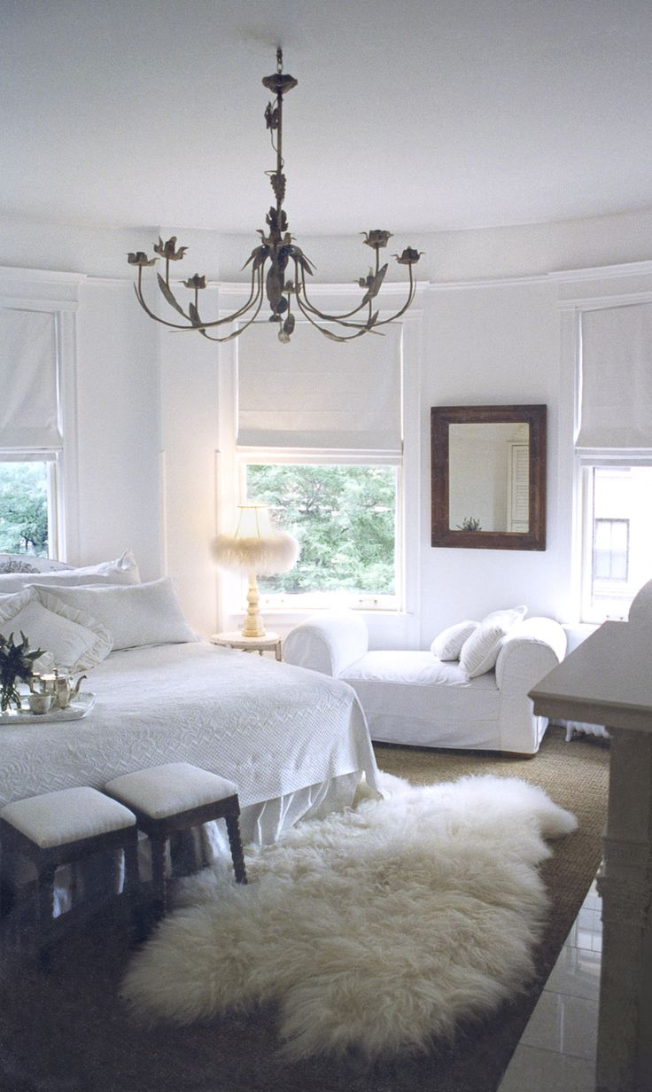 all-white traditional bedroom by Kathleen Clements Design