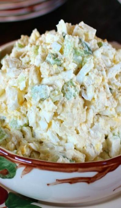 Mom's Vintage Potato Salad - •4 large russet potatoes, cooked and cooled, large dice •8 hard boiled eggs, chopped •1 c. green bell pepper, small dice •1 c. yellow onion, small dice •1 c. celery, chopped •Hellmann's/Best Foods mayonnaise, enough to well-coat all ingredients •celery salt, salt and white pepper to taste