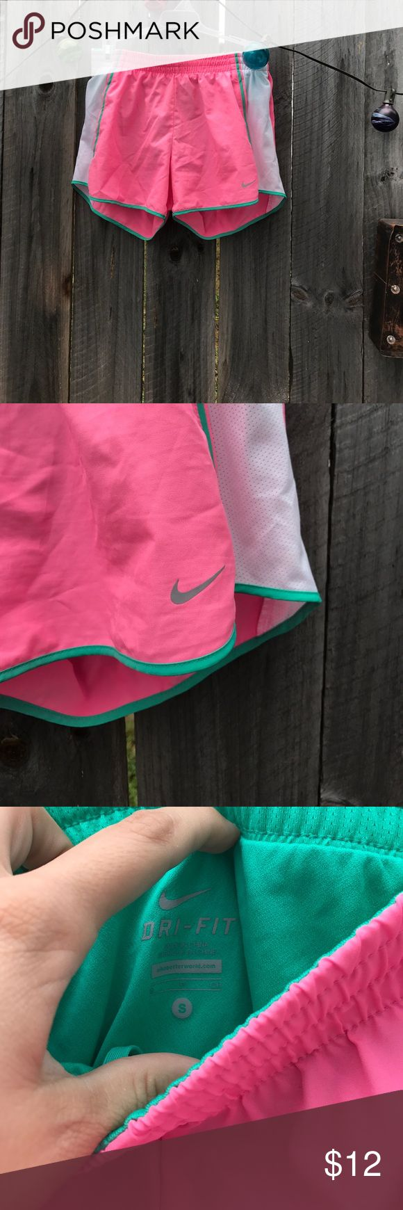 Nike dri fit shorts Pink white and green Nike dri fit shorts. Great condition no rips tears stains. Size small. Two small stash pockets inside. Pet friendly smoke free home. Nike Shorts