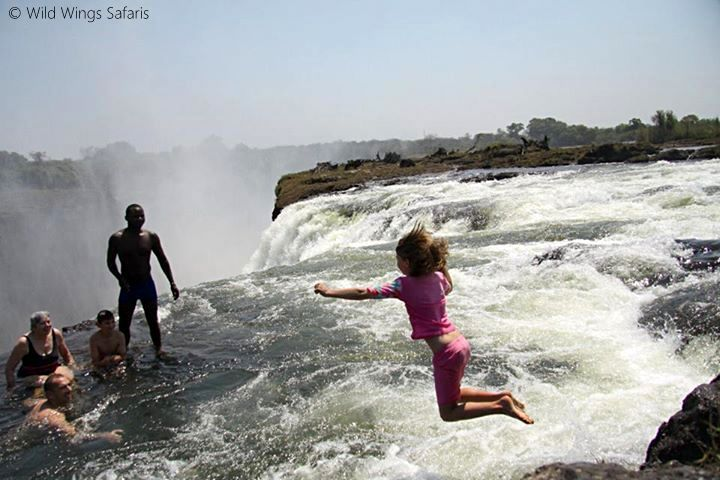 Devil's pool at the edge of Victoria Falls, only accessible in the dry season when the water level is low enough to ensure safety. The ultimate rim-flow pool!
