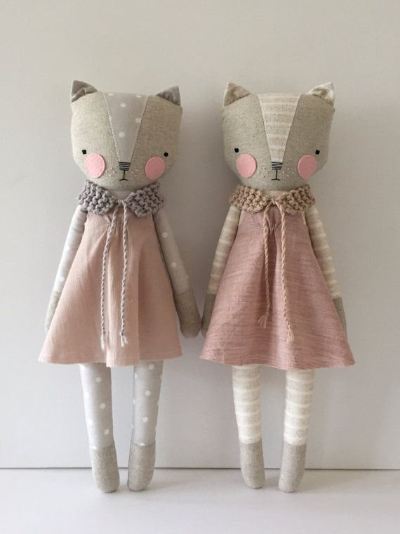 Luckyjuju dolls are handmade from mostly new and sometimes vintage fabrics, felt, lace, ribbon, yarn and polyfill stuffing. The face is hand