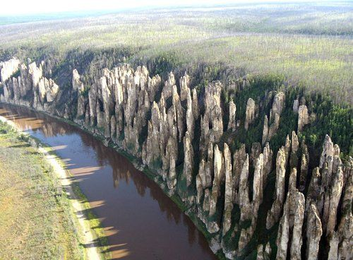 Lena's Stone Pillars (UNESCO World Heritage Site), Yakutsk, Russia -  rock pillars that reach a height of approximately 100 m along the banks of the Lena River. They were produced by the region's extreme continental climate with an annual temperature range of almost 100 degrees Celsius (from –60 °C in winter to +40 °C in summer). The pillars form rocky buttresses isolated from each other by deep and steep gullies developed by frost shattering directed along intervening joints.