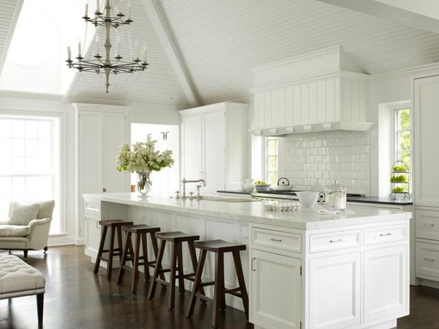 """love everything about this kitchen- ceiling, thick 2 1/4"""" honed slab, glossy tiles, thin black counter on back, dark wide plank floors"""