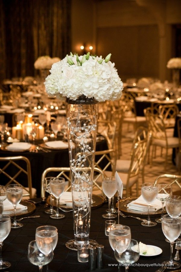 Strands Of White Pearl Balls Decorated Inside Of Tall Glass Vase Centerpiece And White Hydrangea