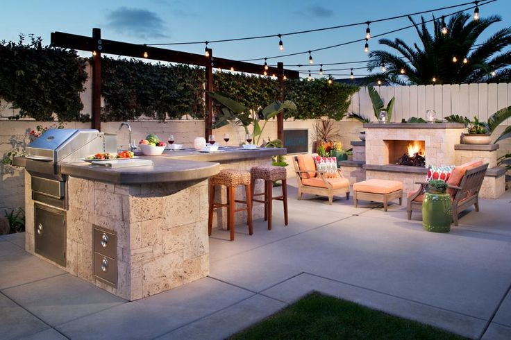 Although this backyard is a small space, it still features lots of potential. A BBQ island adds a grill, sink and plenty of counter space to the mix. An outdoor fireplace serves as a warm spot to gather with friends.
