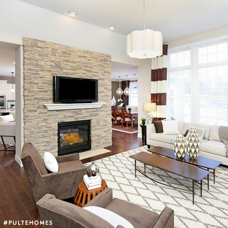 We're in love with this Moroccan-inspired rug and natural hue decor! | Pulte Homes