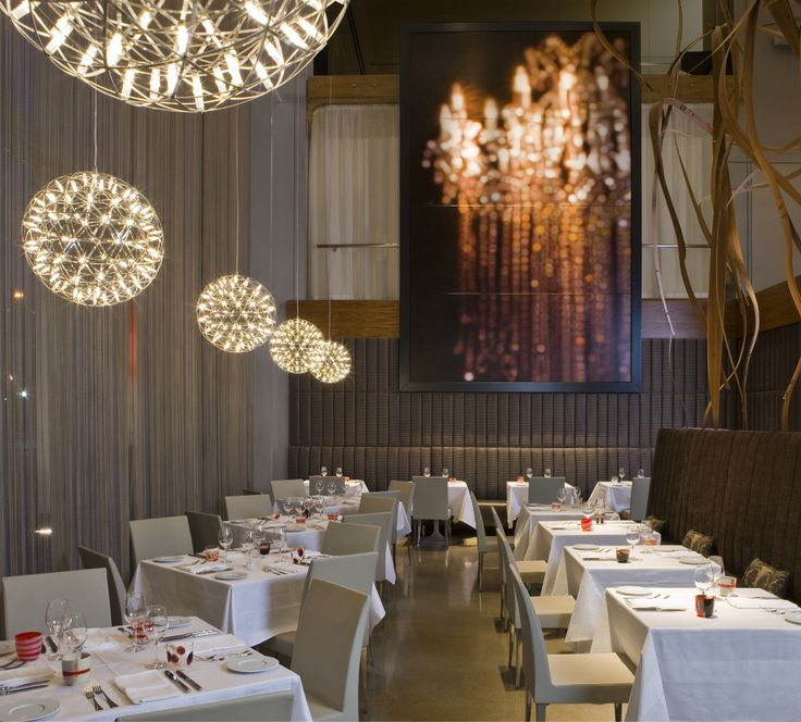 The Elegant Interior Design Of Aria Ristorante Welcomes Guests To Savor Meal And Their Environment