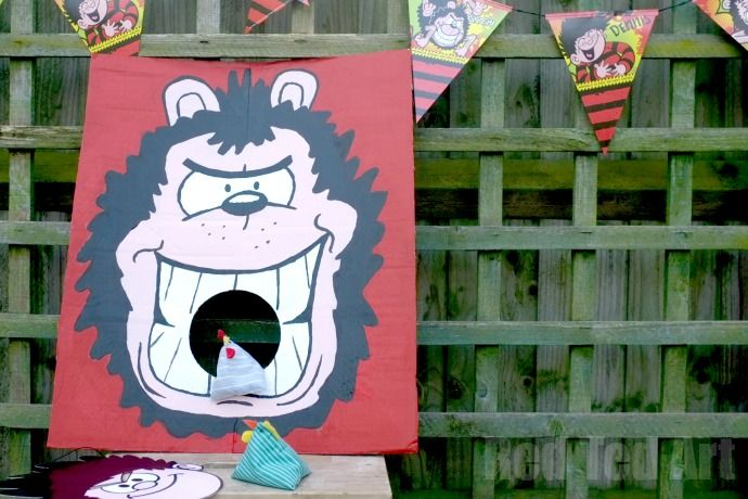 DIY Party Games - Bean Toss Game with Gnasher & Denis the Menance. Upcycle some cardboard into this fun Gnasher Game, includes FREE Printable!