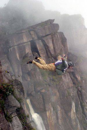 Base jump off Angel Falls- Venezuela  I'm definitely not what you would call a thrill-seeker but this would make me want to become one.