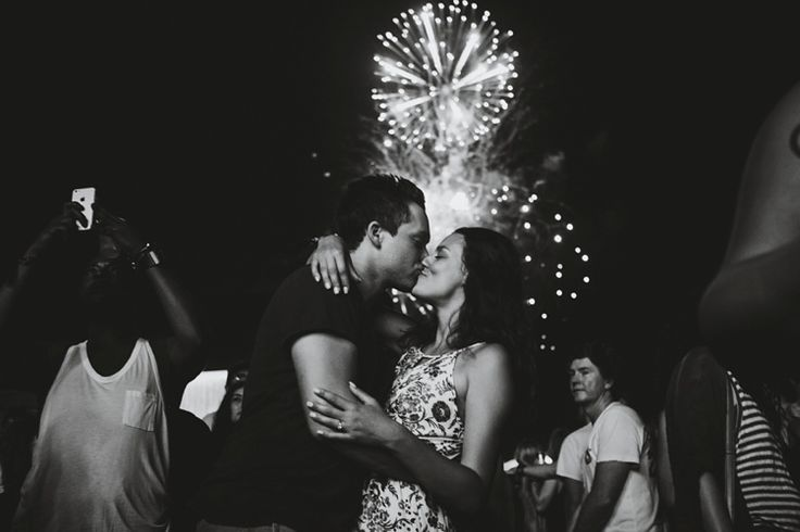 Kissing in front of the fireworks at Arcade Fire WayHome set #taralillyphotography