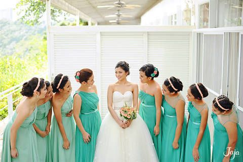 bridesmaids channeled freshness in matching dresses in cheery shades of green.