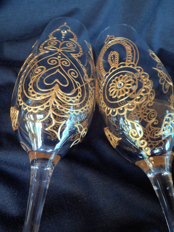 Mehndi Arm Glass : Champagne flutes hand painted in mehndi style designs