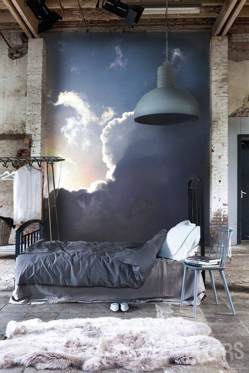 Bedroom with evening sky photo mural - love the oversized light shade and the sheepskin rug. Great texture.