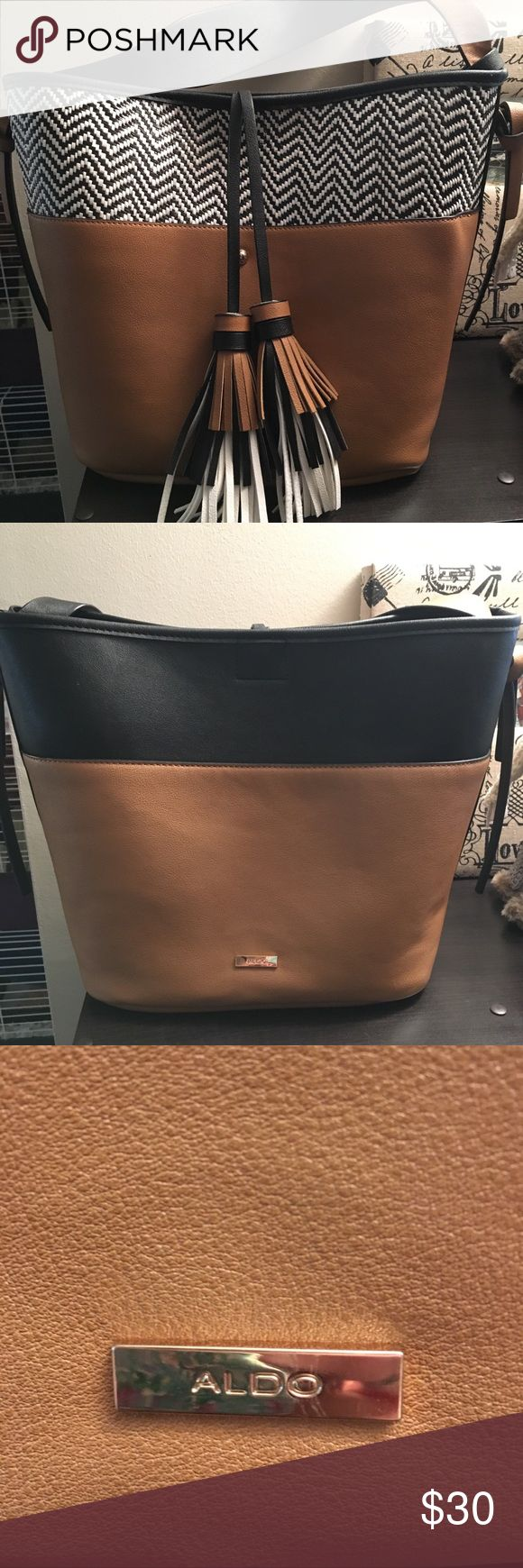 Large Aldo handbag Large Aldo handbag. Brown white and black so it goes with everything. Front pocket and removable inside pocket. It's the perfect size for an everyday bag! Aldo Bags Shoulder Bags
