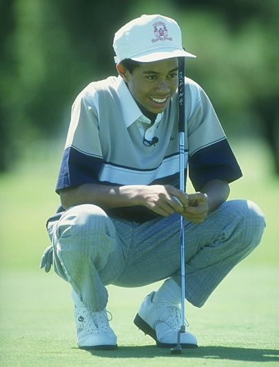 July 23, 2000 Tiger Woods became the youngest golfer to complete a career Grand Slam when he won the British Open at age 24.
