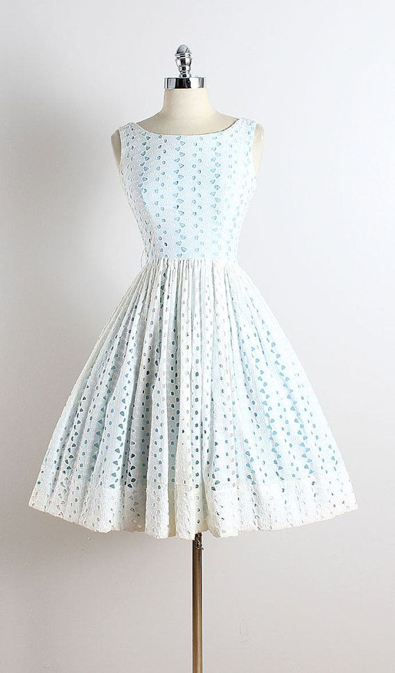 ➳ vintage 1950s dress * white eyelet cotton * blue cotton lining * leaf embroidery * metal back zipper  condition | excellent  fits like xs  dress length 39.5 bodice 16 bust 34 waist 24 hem allowance 4   ➳ shop http://www.etsy.com/shop/millstreetvintage?ref=si_shop  ➳ shop policies http://www.etsy.com/shop/millstreetvintage/policy  twitter | MillStVintage facebook | millstreetvintage instagram | millstreetvintage  5775/1624