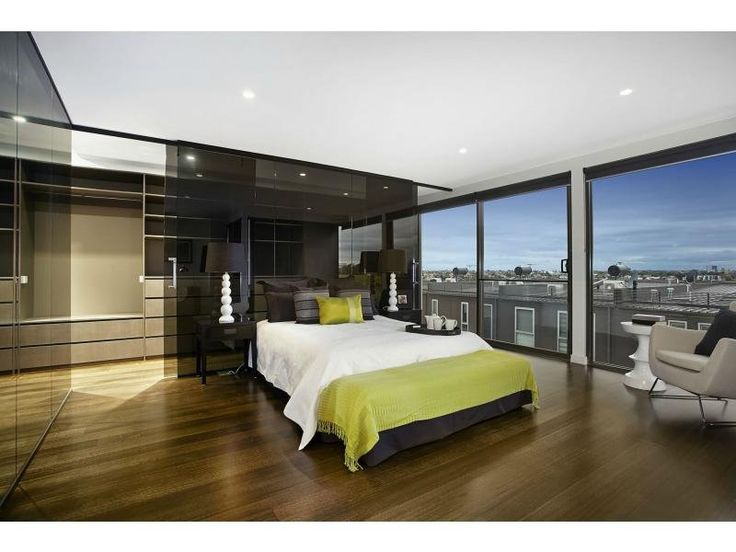 Main master bedroom with built in robe on second level - looking out at views