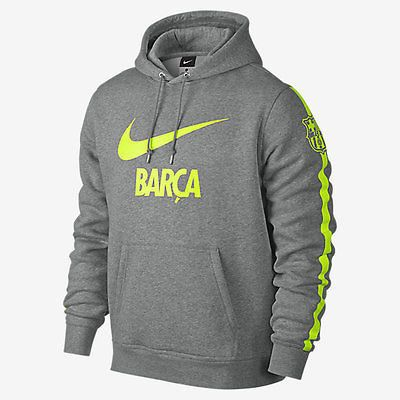 NIKE FC BARCELONA CORE HOODIE Grey Heather/Volt LOYAL LOOK WITH A SOFT FEEL The FC Barcelona Club Core Men's Hoodie features team graphics on a soft cotton blend for unmistakable pride and warm comfor