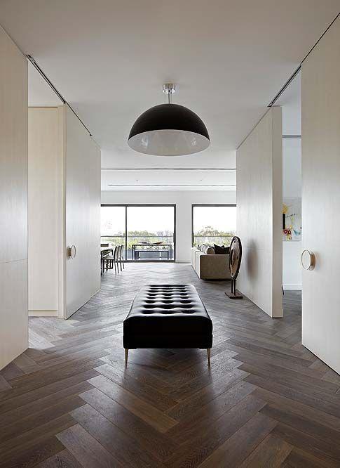 minimal, black pendant, black leather, herringbone wood floor