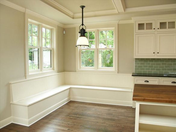 if i could come up with my perfect kitchen... this would probably be it (and i can't even see the whole thing). but i do love what i see.... the bench, that light, the white cabinets, the ceiling, the butcher block island, and the subway tiles. oh my. kitchen heaven.