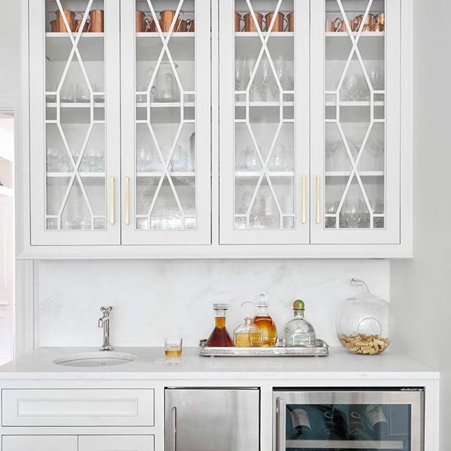 bar design by jenkins interiors | marble and white bar | built in wine fridge