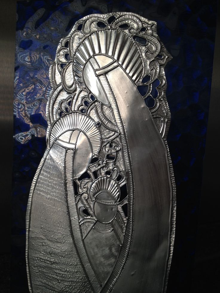 Pesebre repujados en aluminio sobre vidrio de Carolina VP