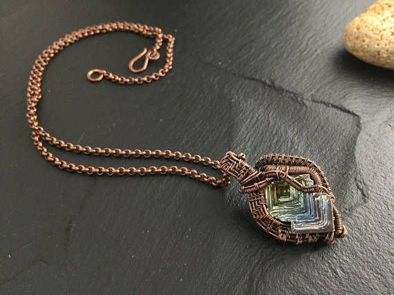 Amazing reversible bismuth crystal pyramid pendant . Created and designed by me using solid copper wires , the bismuth crystal is nicely secured onto the wrap and both sides and beautiful and wearable .  The necklace is a 20 Saturday rolo chain in solid copper wire with handmade S hook clasp. The pendant is presented on a female display but it is actually unisex and can be worn by both male and females . Pendant measures 1.5 X1 with bail .  🌺 Handmade with love and aloha on Kauai 🌺