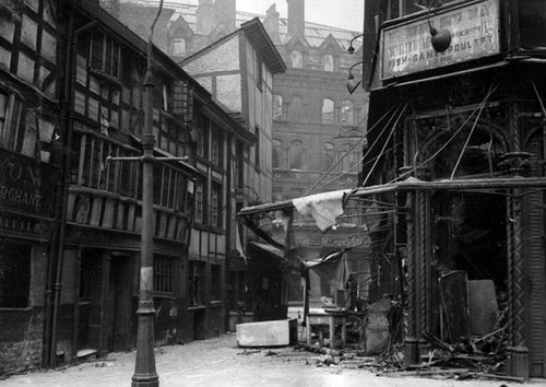 The Manchester Shambles after a World War 2 air raid. The Shambles, consisting of some of the earliest surviving Manchester buildings reached the end of the war with no further damage. In 1974 the buildings were moved to a new location and moved again after the 1996 Manchester bombing. The Shambles contains the Old Wellington Inn and Sinclair's Oyster Bar.