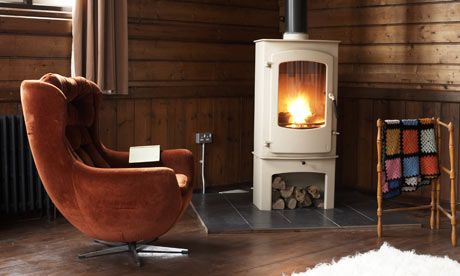 I like the idea of having a mantel built up around the stove in our living room with some kind of hearth like this... I like having a place for storing wood like this...