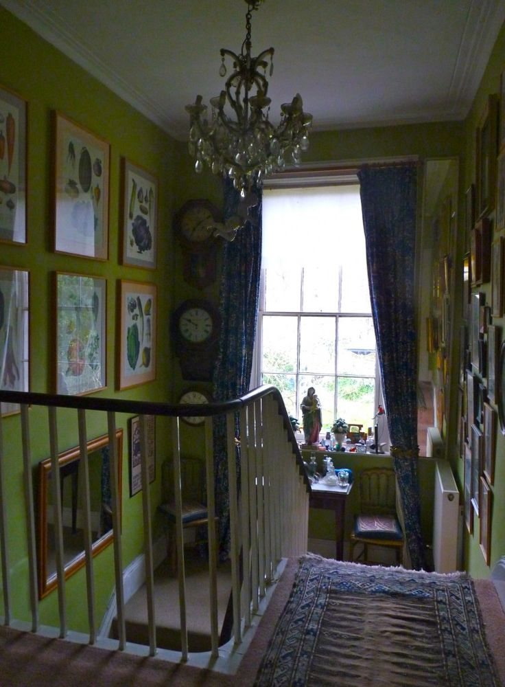 At the half-landing window, glazed chintz curtains are a William Morris design, long since out of production from a house on the Thames from Bible of British Taste