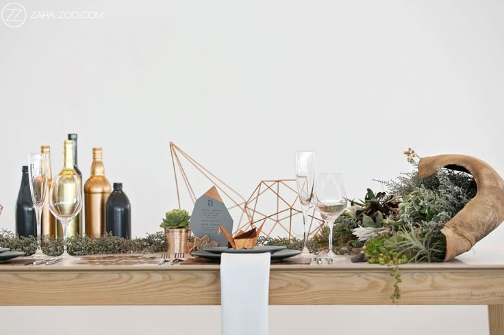 Copper and Grey inspired table setting for your Wedding with Geometric shape decor elements and greenery.