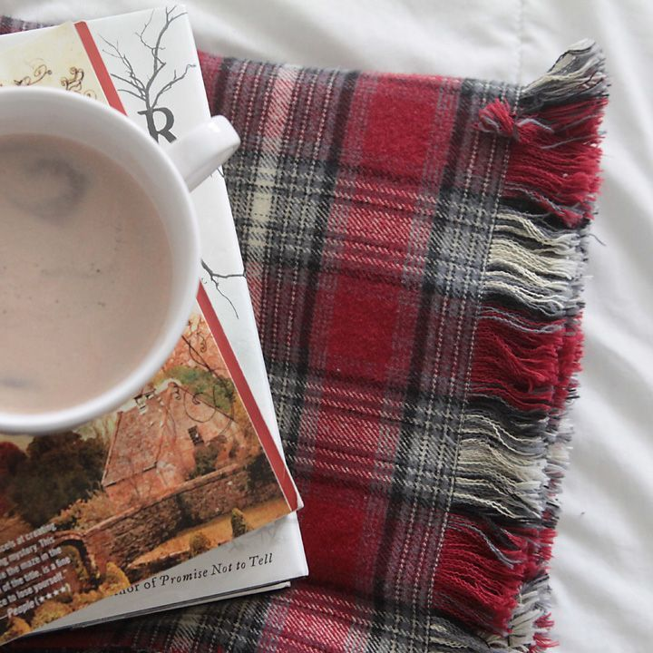 This DIY fringed flannel throw is pretty, cozy, and easy to make! It's the perfect handmade Christmas gift idea. How to make a simple flannel blanket.