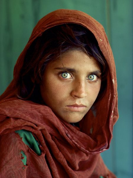 "Just an amazing shot - ""Afghan Girl"" - When he wandered into an Afghan refugee camp in Pakistan in December 1984, National Geographic photographer Steve McCurry captured one of the most famous portraits the world had ever seen. The Afghan girl with the haunting green eyes captivated everyone."