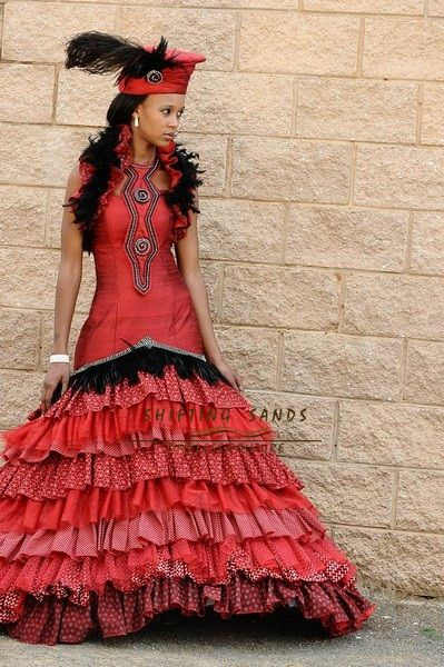 Ntombi - Shifting Sands Traditional African Zulu inspired red silk and shwe shwe frill wedding dress with hat.