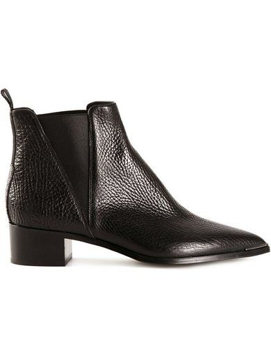 'Black leather 'Jensen Grain' boots from Acne Studios featuring a pointed toe, elasticated side panels, a pull tab at the rear and a low block heel.'