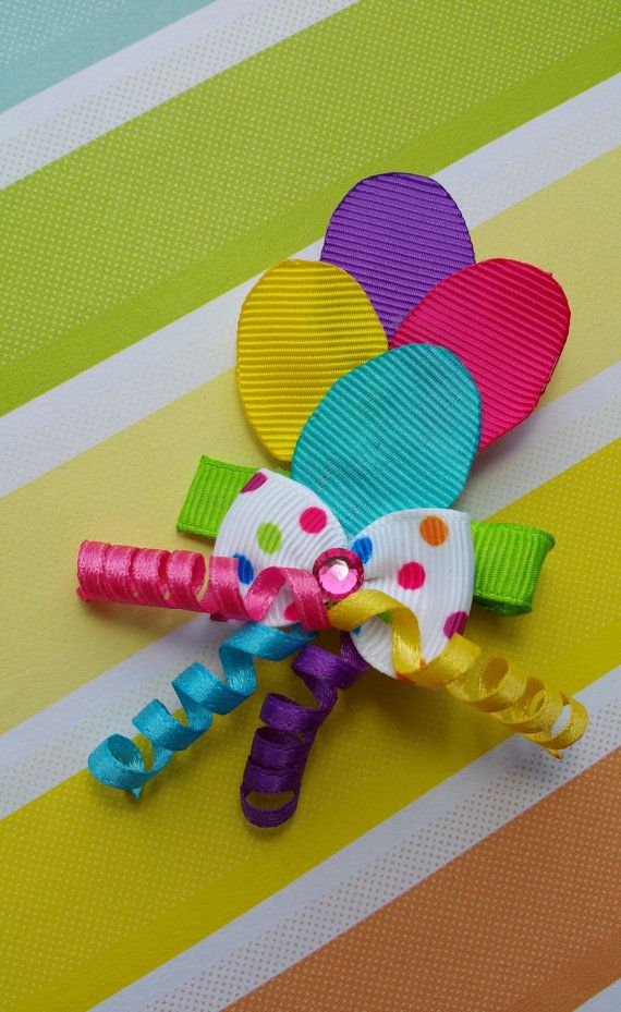 High flying Balloons for your little cutie! She will not be disappointed because these do not fly away! Whether its her birthday or a special day she will be stylin!  balloon ribbon colours: purple, yellow, hot pink and blue. All ends of the Grosgrain ribbon were heat sealed to prevent