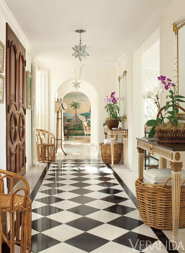 Lyford Cay, Villa Contenta, interior design by Andrew Raquet, photo by Max Kim-Bee, Veranda.com, Star fixtures, Charles Edwards. Vintage rattan chairs. Consoles, McLain Wiesand. Mirrors, Mirror Fair.