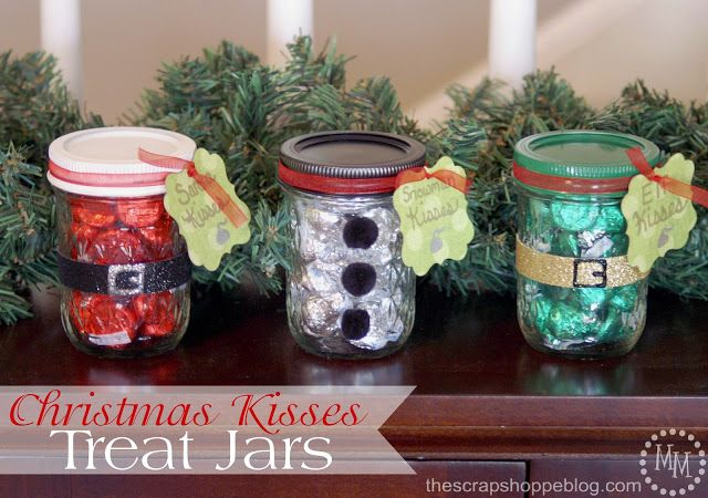 Christmas Kisses Treat Jars: The red Hershey Kisses are meant to represent Santa Claus, and the green a Christmas elf. The silver Hershey Kisses with the black lid is a snowman.