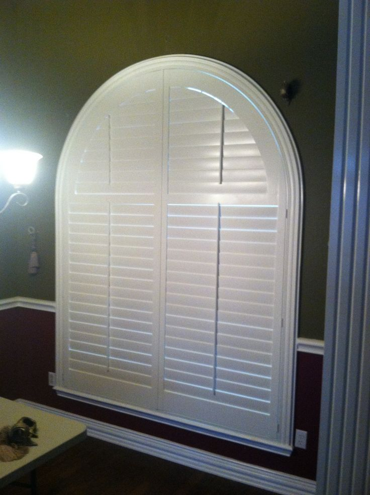 """3 1/2"""" louvered real wood arched shutters with decorative frame! This window was 6 ft wide by 8 ft tall!!! HUGE window, but turned out beautifully!! Budget Blinds of East Texas can handle these window treatment needs, no sweat!! Call us 903-561-6767 for your FREE In Home Consultation!"""