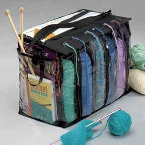 "Take Your Knitting Anywhere With the Portable Yarn Tote! Individual compartments hold three to six skeins of yarn in perfect order. Thread yarn through the grommets in the lid to prevent tangling, dirt and fraying while you work. Roomy pockets hold needles, gauges and pattern books. Carrying strap, zip closure, clear PVC reinforced with polyester. 12""Hx15""Wx9½""D."