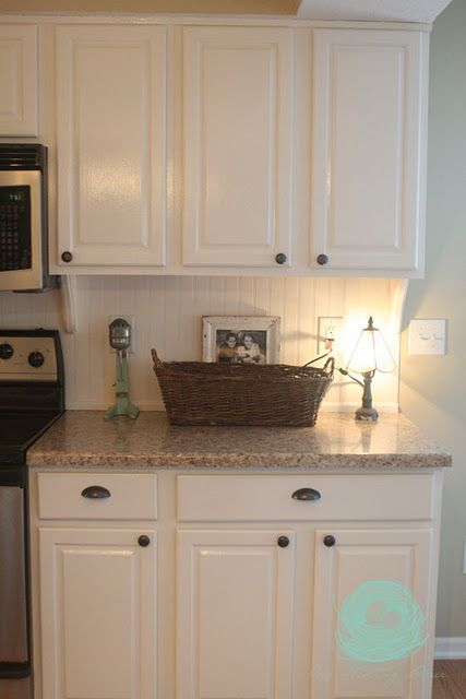 Beadboard backsplash wow these are my cabinets and countertop!! love the beadboard backsplash, will have to think about that