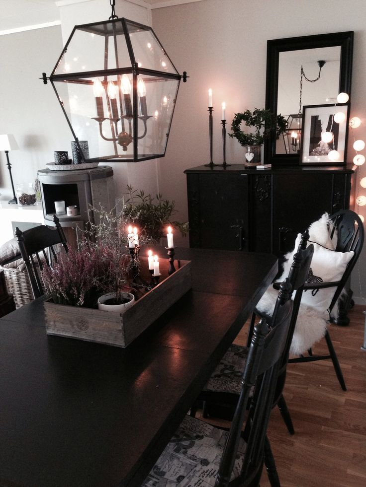 Black diningtable, black chairs, black cupboard, heather