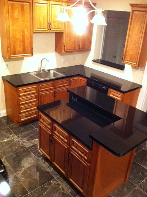 Carriage house biltmore cabinets with night armour black for Carriage house kitchen cabinets