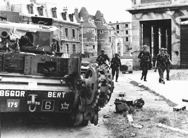 "German soldiers pass by a Canadian ""Churchill"" tank nicknamed ""Bert"" on the street of French Dieppe. My grandfather was a member of the crew in the tank named ""Bob"" who helped save the crew of this tank, and brought them back to the beach. Ironically, my great-uncle Bert was also a member of Bob's crew."