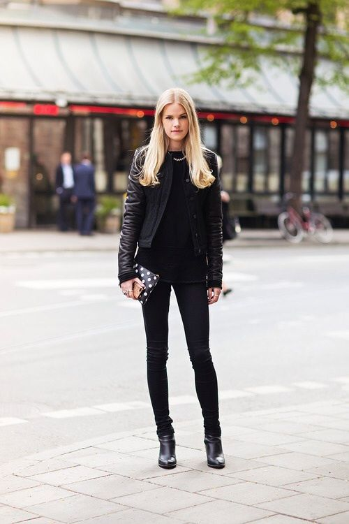 Shop this look on Lookastic: https://lookastic.com/women/looks/bomber-jacket-sleeveless-top-skinny-jeans-ankle-boots-clutch-necklace/2720 — Black Leather Bomber Jacket — Black Sleeveless Top — Black Skinny Jeans — Black and White Polka Dot Leather Clutch — Black Leather Ankle Boots — Gold Necklace