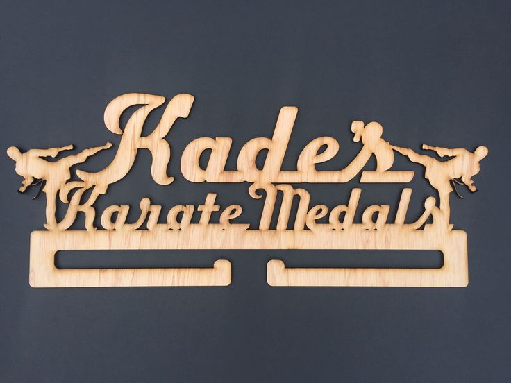 Kade is great at karate and will hang his medals with pride on his karate medal holder