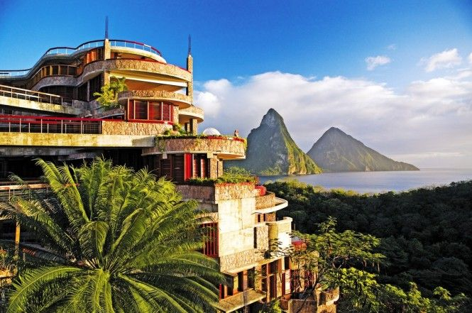 Surrounded by the stunning scenic beauty that is St Lucia, Jade Mountain reaches up toward blue skies above Anse Chastanet, the 600 acre beachfront resort below.