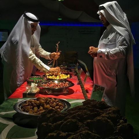 """Saudi men presenting different types of dates for the visitors at Festival for Dates & Palm Trees in Jubail Industrial City in Saudi Arabia. iPhone photo…"""