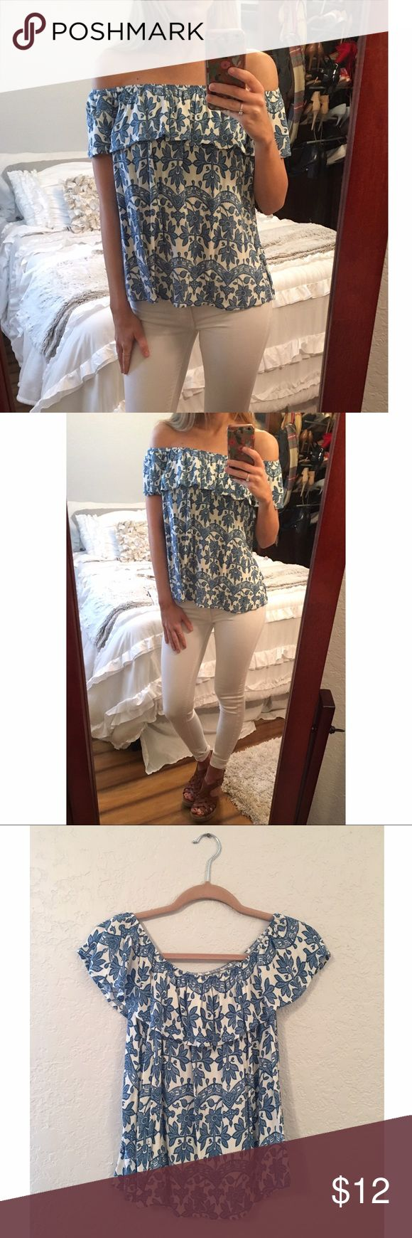 Off-the-Shoulder Blue and White Blouse This off-the-shoulder blue and white blouse was originally purchased from Impressions Online Boutique. Super soft fabric with a gorgeous blue and white design. Perfect lightweight for spring and summer. Size S. Offers considered. Tops Blouses