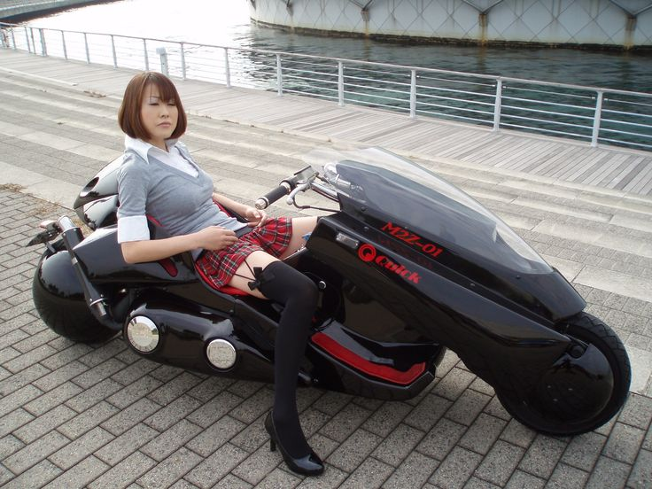 Future bike, what is with Asian girls and tartan skirts,.... bit scottish?